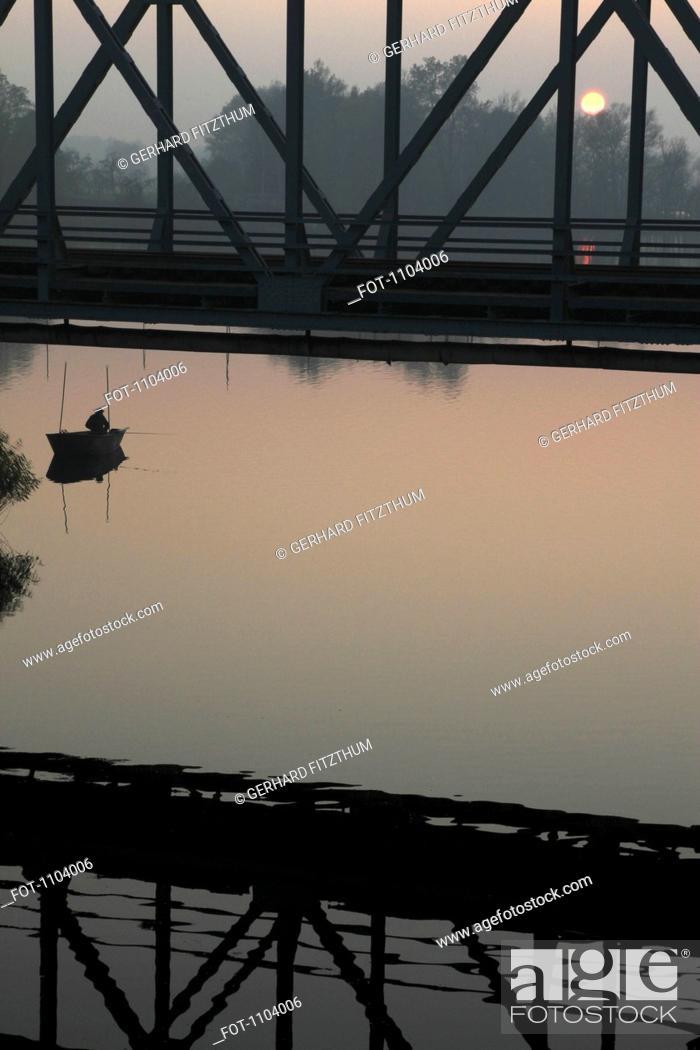 Stock Photo: A fisherman at sunrise, Lake Havel, Brandenburg, Germany.