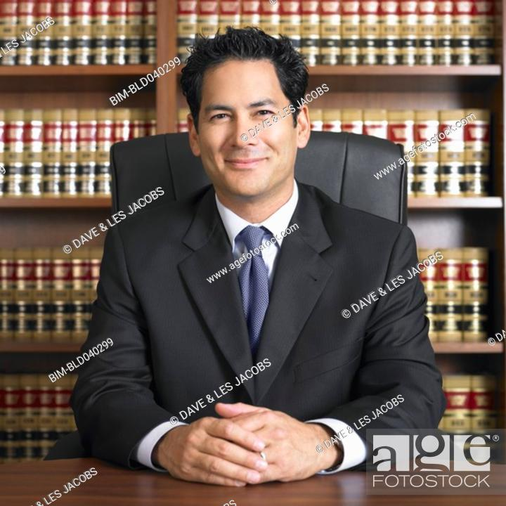 Stock Photo: Mixed Race male lawyer at desk.