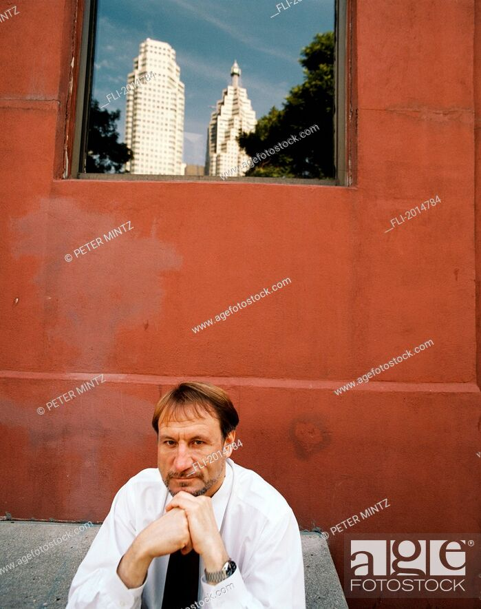 Stock Photo: Businessman Sitting In Front Of Building, Toronto, Ontario.