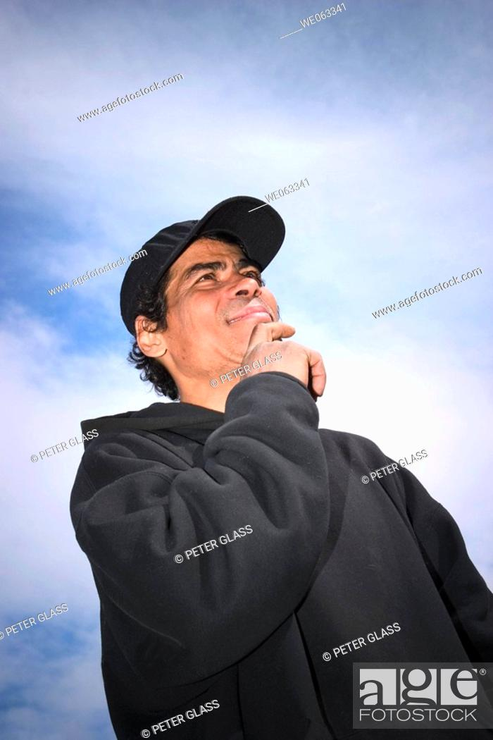 Stock Photo: Young Hispanic man, wearing a hat, posing.