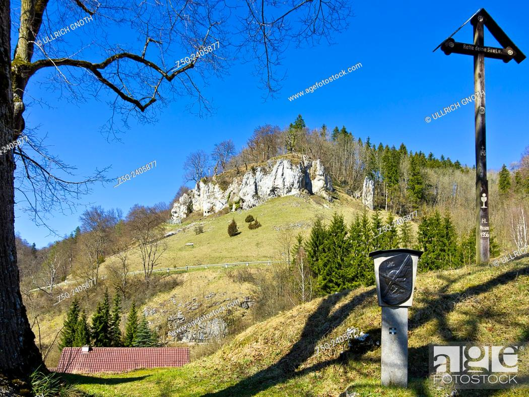 Stock Photo: View of limestone rocks from a station of a Way of the Cross in the village of Hutten, Swabian Alb, Germany.