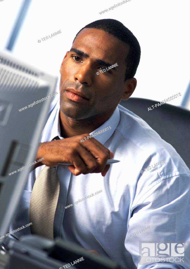 Stock Photo: Businessman looking at computer monitor.