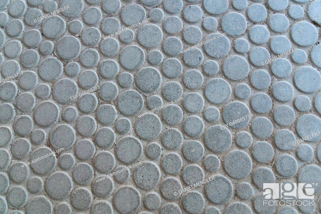 round large gray stone plates laid on