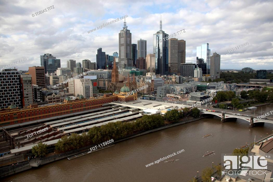 Stock Photo: Cityscape of Melbourne with Flinders Street Station and the Yarra River.