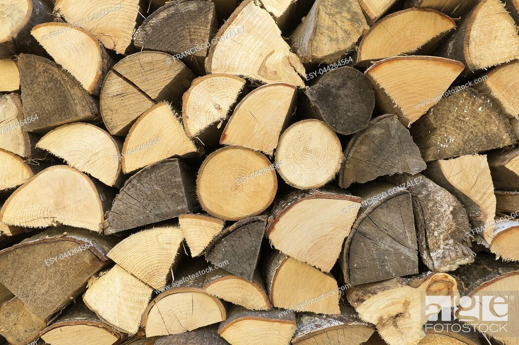 Stock Photo: Wooden logs arranged in a wood of a Swiss village. Horizontal shot with natural light.