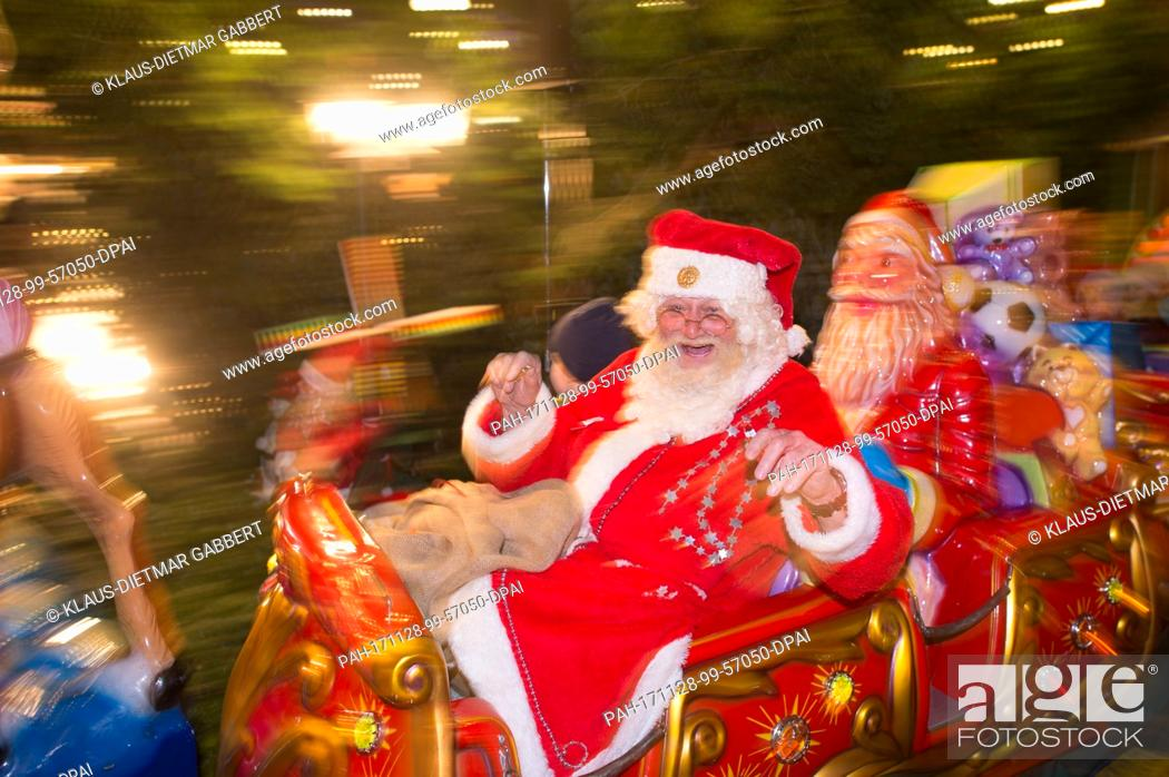 The Christmas Clause.Peter Duehring Who Is Dressed As Santa Clause Enjoys A Joy