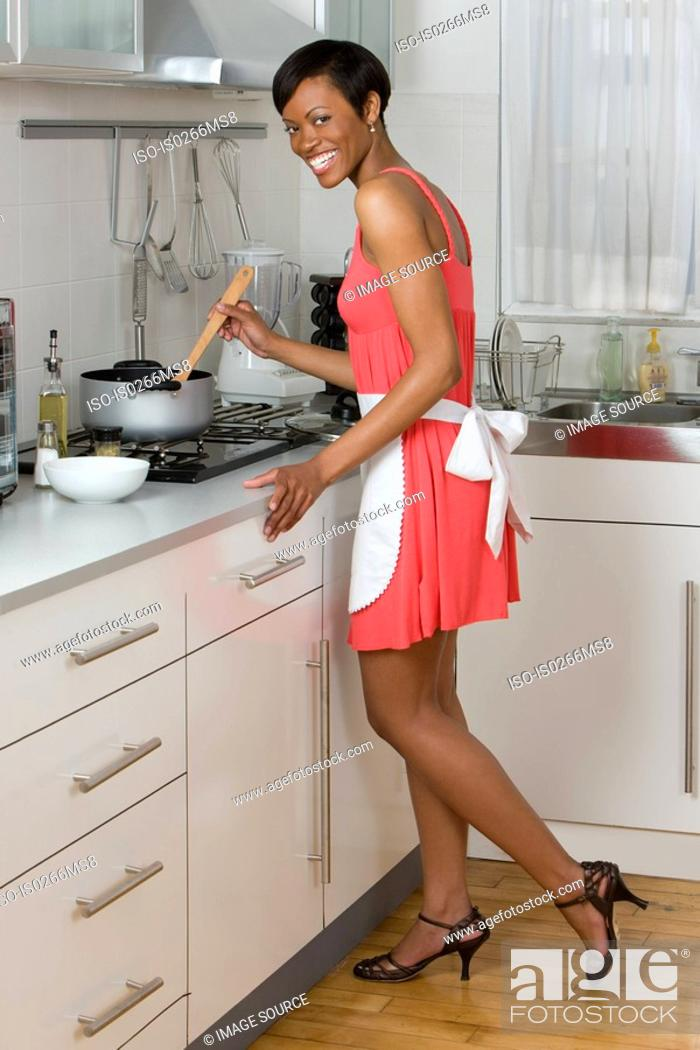 Stock Photo: A woman cooking.