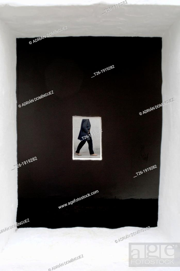 Stock Photo: View throw a window of a man walking.