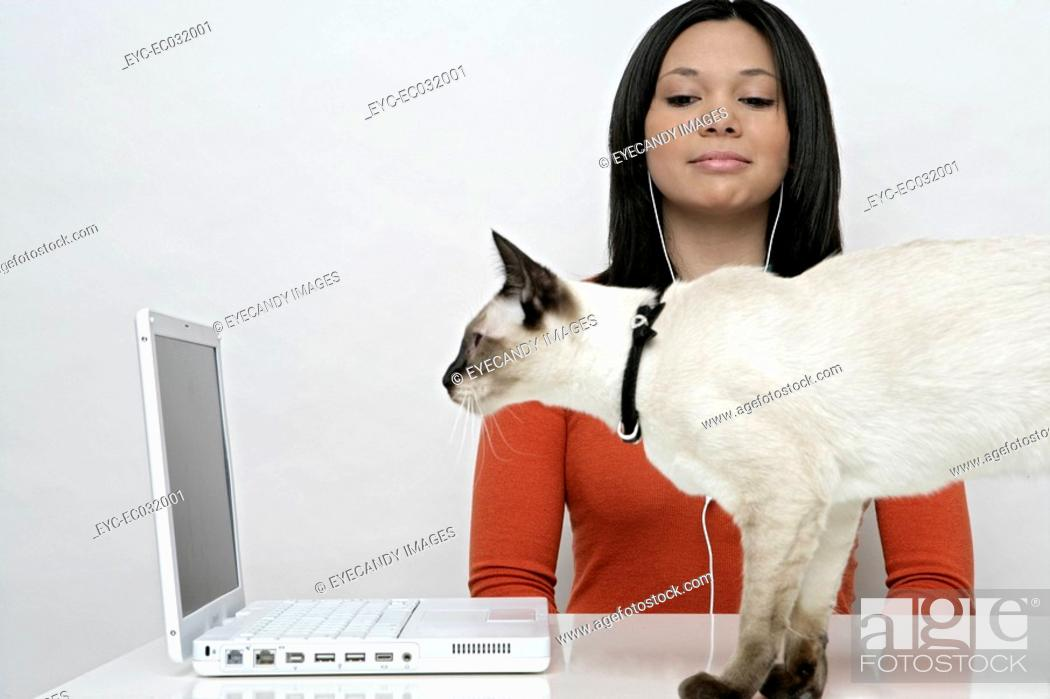 Stock Photo: View of a teenage girl with a cat.