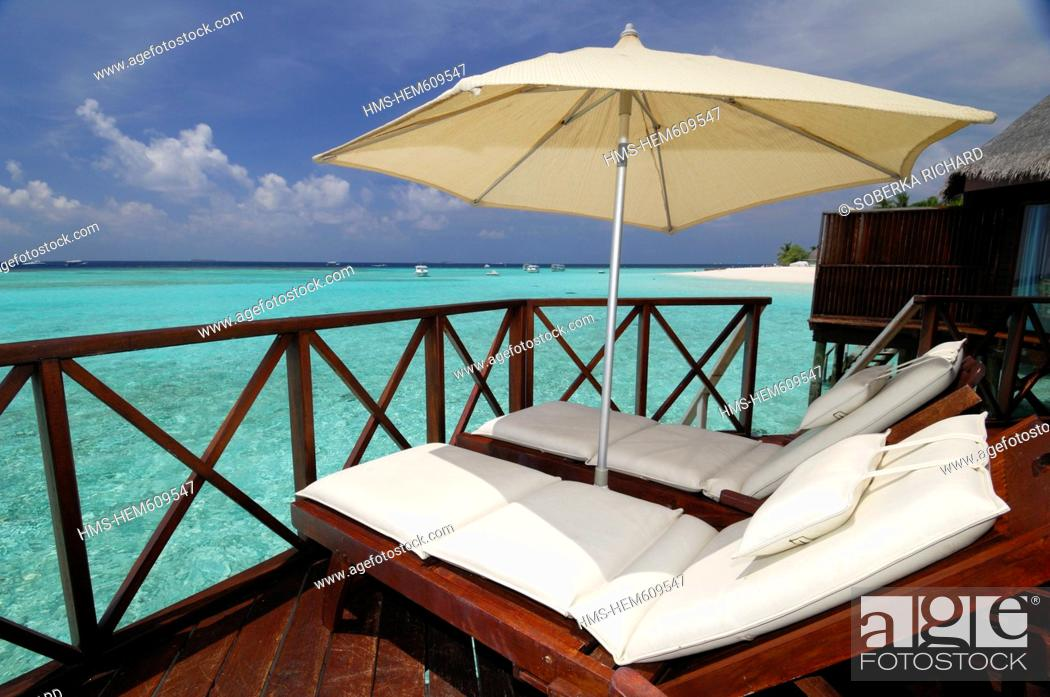 Stock Photo: Maldives, North Male Atoll, Thulhagiri Island, Thulhagiri Resort and Spa, lounge chairs by the lagoon, along the turquoise sea and bungalow.