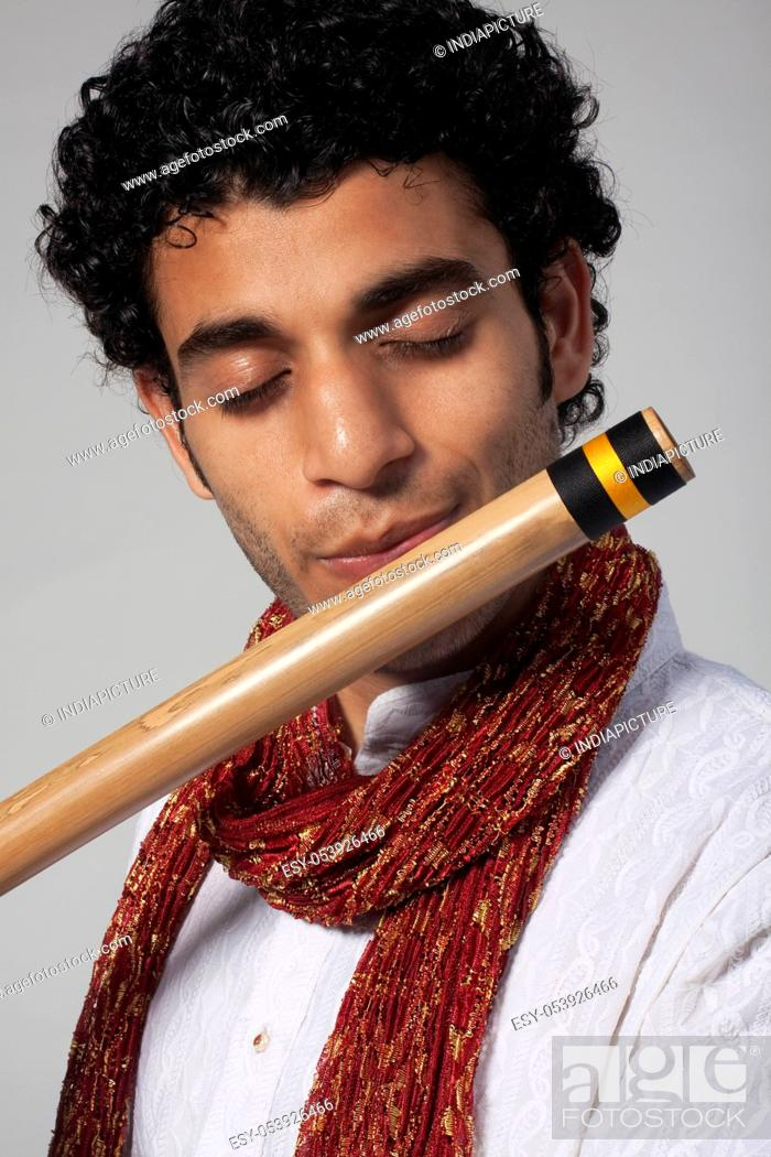 Stock Photo: Man playing the flute.