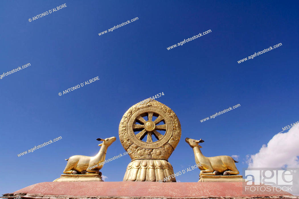 Stock Photo: the law wheel on the roof of the jokhang temple. barkhor district. lhasa. lhasa prefecture. tibet. china. asia.