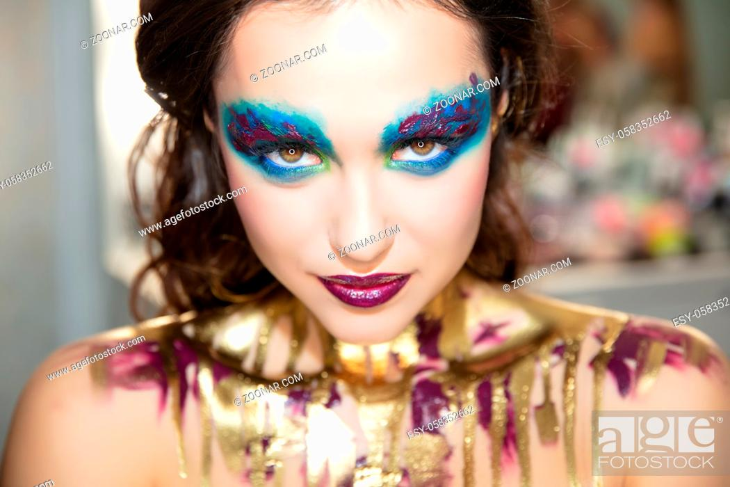Stock Photo: Pretty young brunette with creative make up and body painting.
