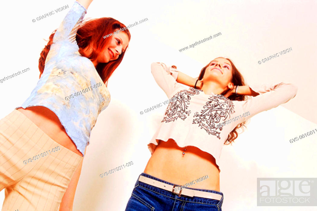 Stock Photo: Two young women stretching.
