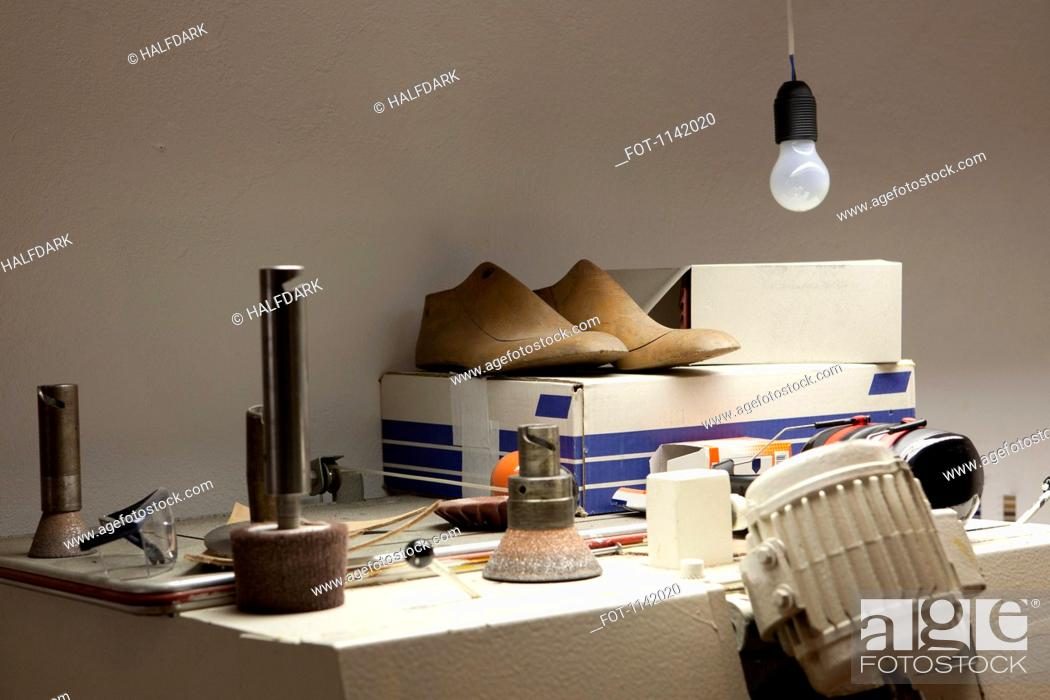 Stock Photo: Detail of the workshop of a shoemaker.