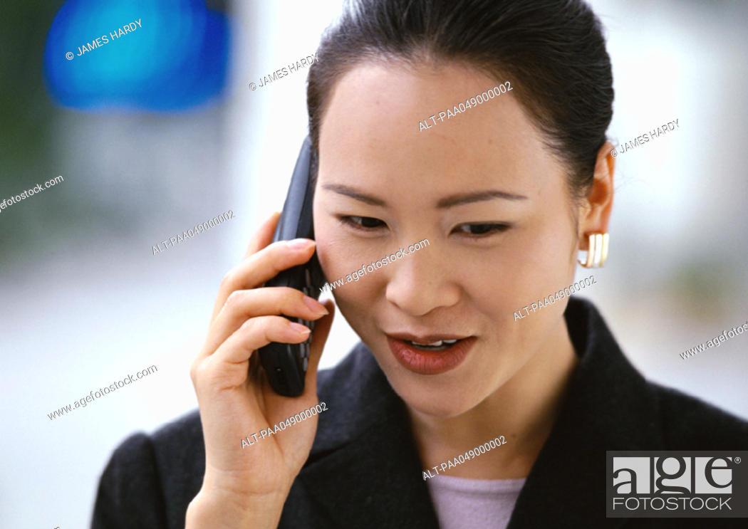 Stock Photo: Woman holding phone, portrait.
