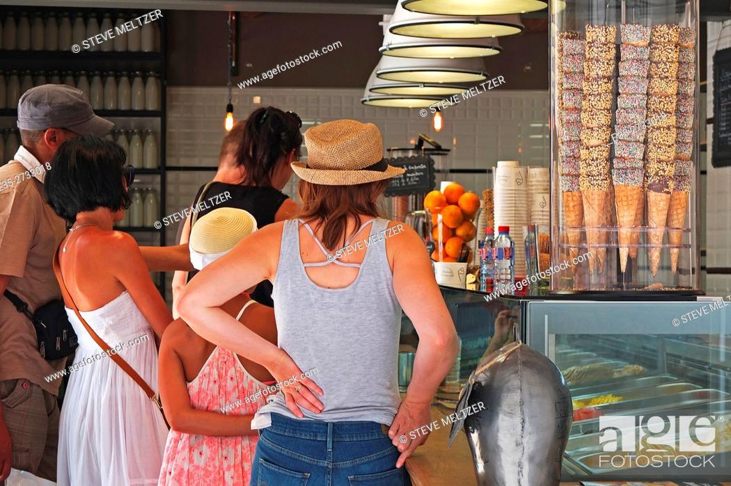 Stock Photo: Tourists line up to buy ice cream.