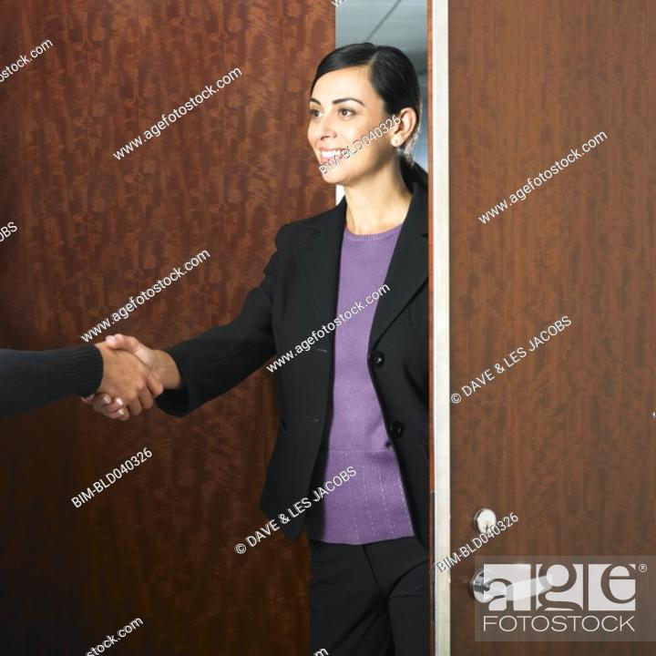 Stock Photo: Hispanic businesswoman shaking hands.