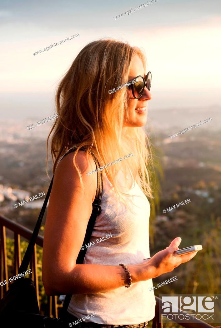 Stock Photo: Woman on viewing platform overlooking town, Mijas Pueblo, Andalucia, Spain.