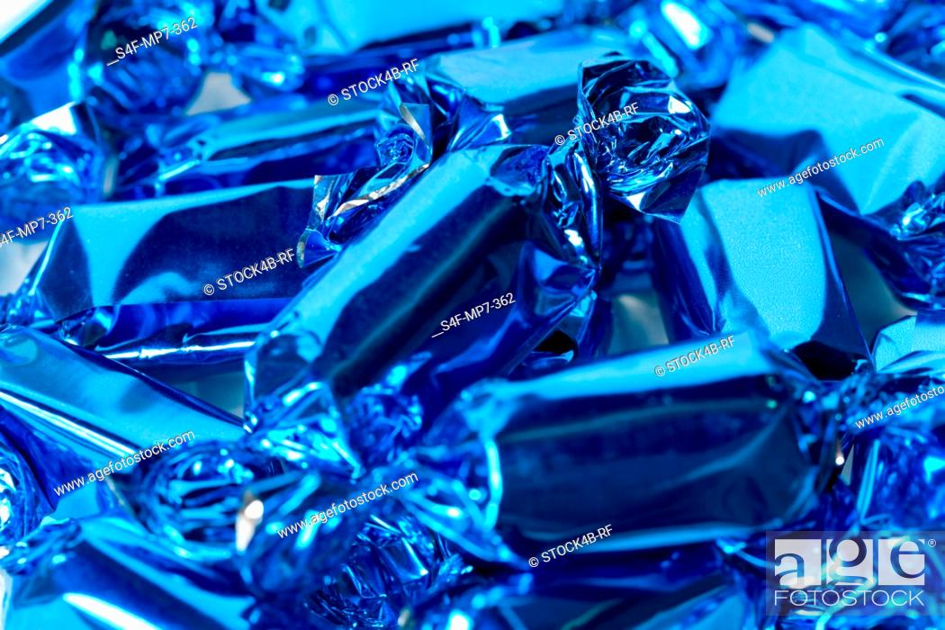Stock Photo: Detail of hard candies wrapped in blue foil.