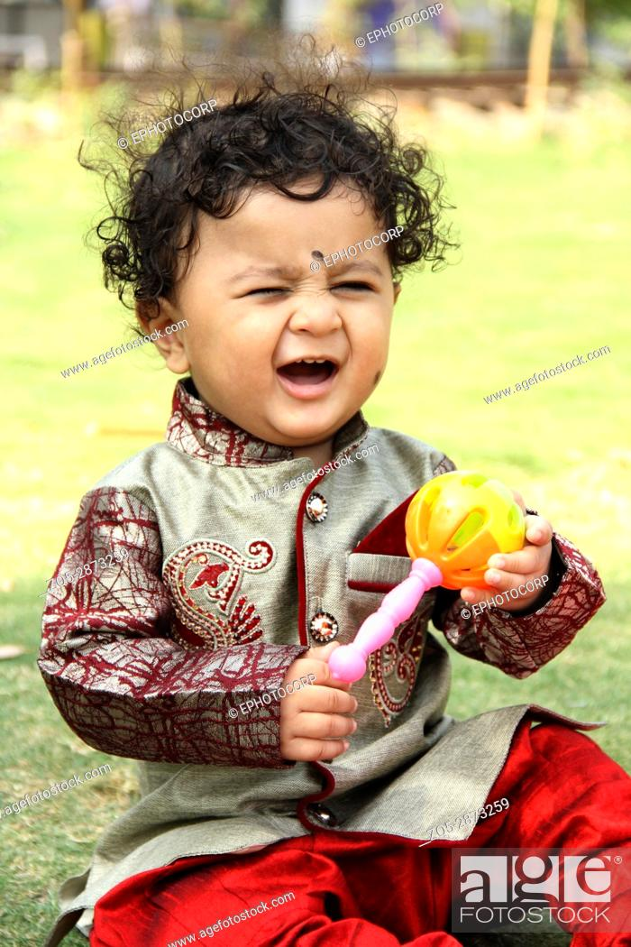 Stock Photo: Cute little child with Khulkhula, also known as Maracas or Rumba shakers.