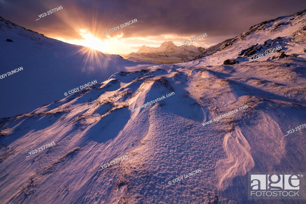 Stock Photo: Winter sunrise over mountain landscape, Moskenesøy, Lofoten Islands, Norway.