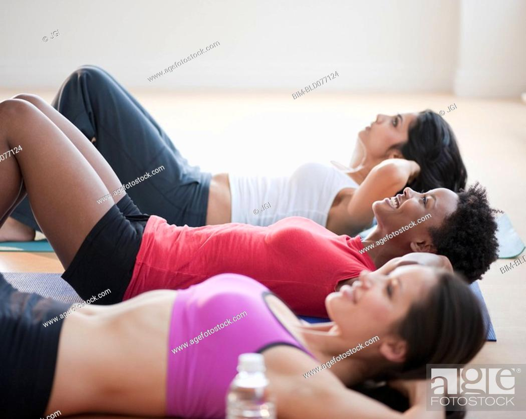 Stock Photo: Friends exercising together.