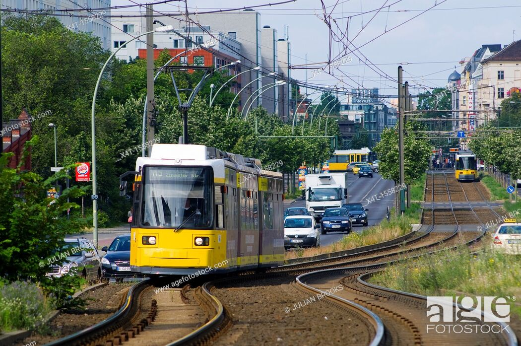 Stock Photo: Modern trams on the streets of the former East Berlin with busy traffic.