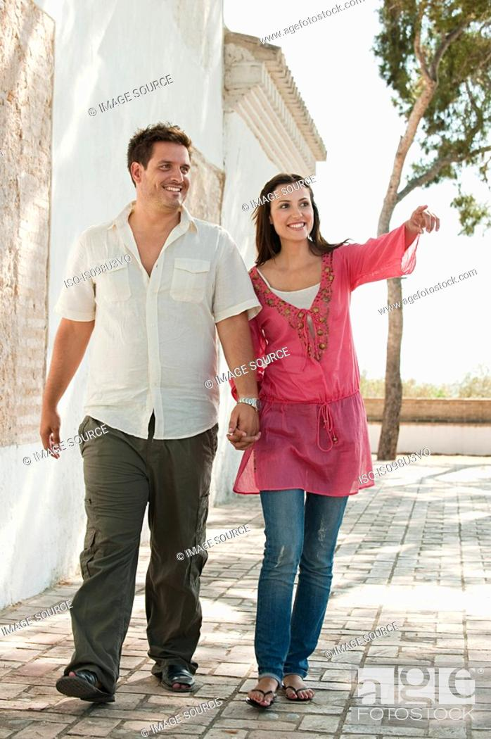 Stock Photo: Young couple walking on holiday.