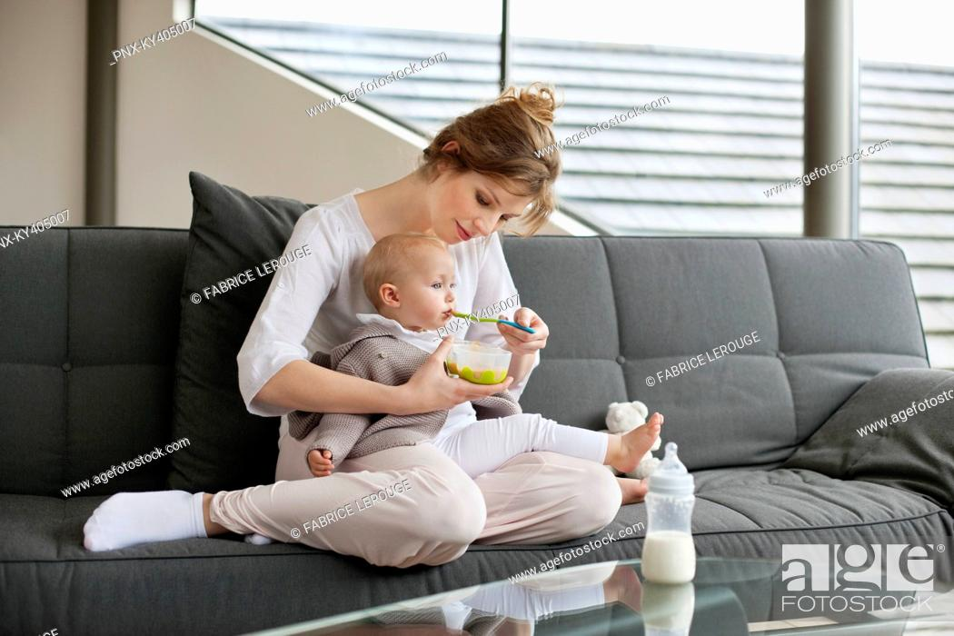 Stock Photo: Woman feeding her daughter.