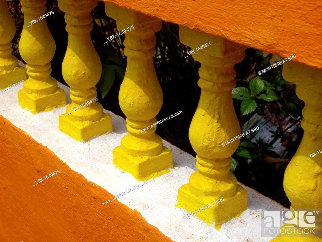 Stock Photo: Rough painted orange, white and yellow balustrade.