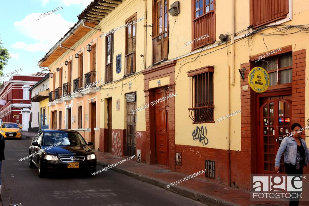 Stock Photo: Bogotá, Colombia - May 28, 2017: Traffic drives through the old town area of La Candelaria in the Andean Capital city. Most buildings in the area go back to the.