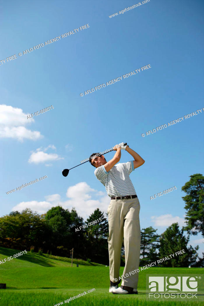 Stock Photo: Man teeing off with a driver.
