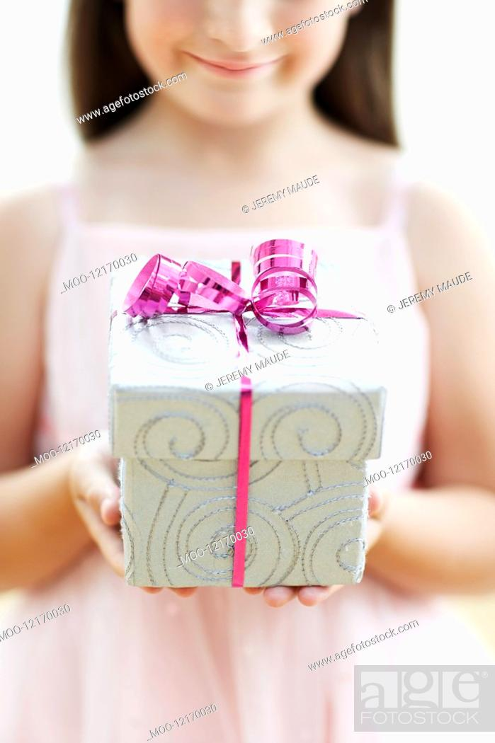Stock Photo: Smiling Girl with Gift mid section close up.