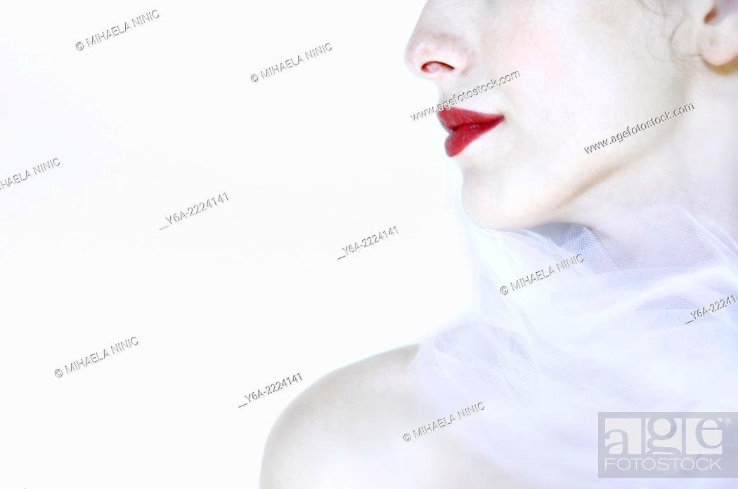 Stock Photo: Young woman wearing red lipstick, close-up.