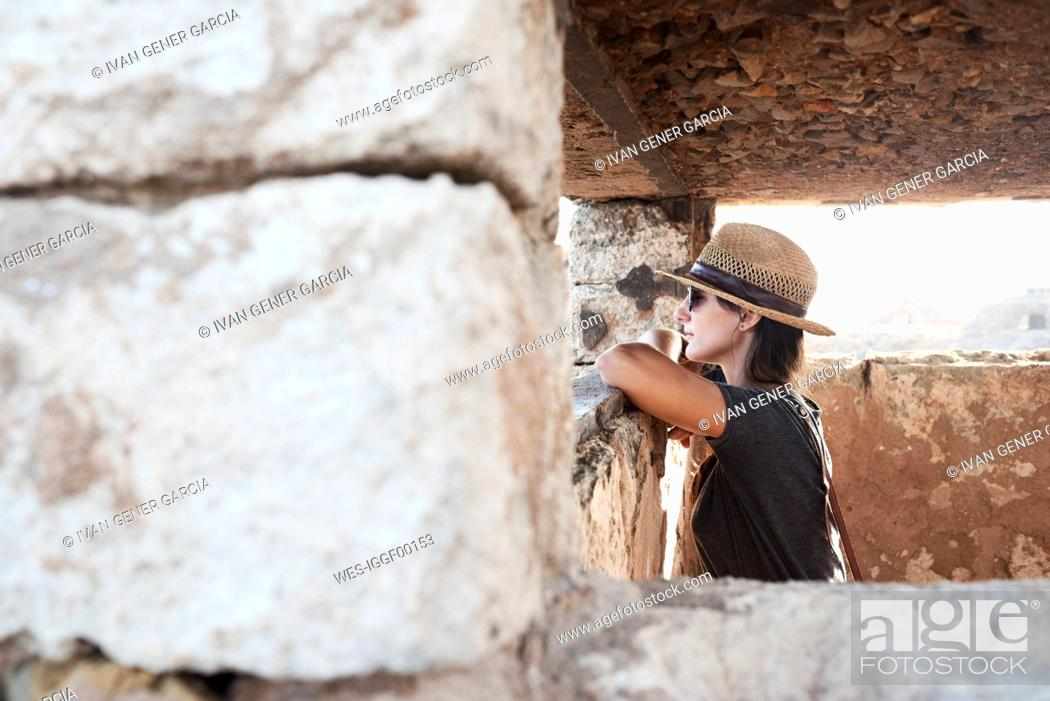 Stock Photo: Spain, Menorca, woman inside building looking at view.
