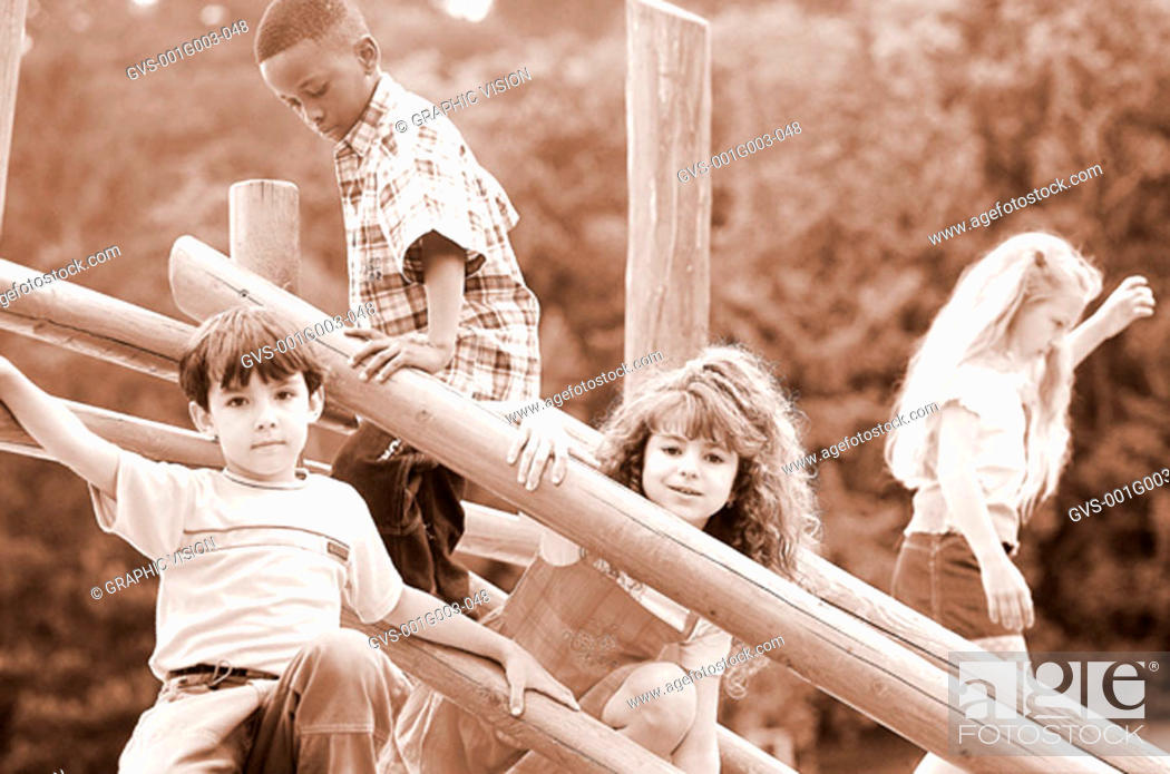 Stock Photo: Young children playing together on a jungle gym.
