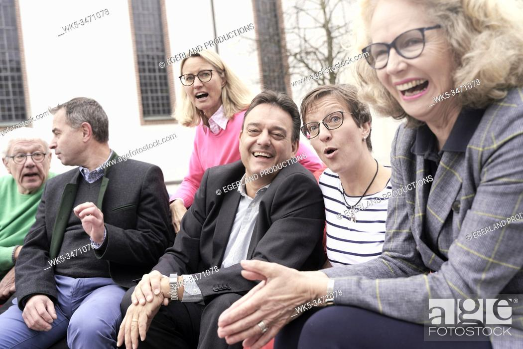 Stock Photo: Group of friends sitting outdoors.
