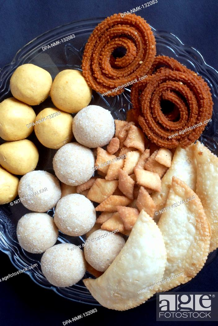 Stock Photo: Besan Ladoo ; Rava Ladoo ; Karanji ; Shankarpali and Bhajani Chakli ; Homemade Maharashtrian Food made for Diwali Deepavali festival ; Mumbai Bombay ;.