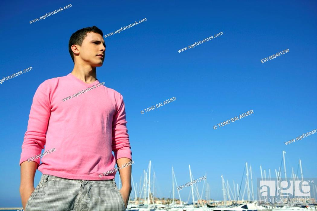 Stock Photo: Handsome young man on summer in harbor, blue sky.