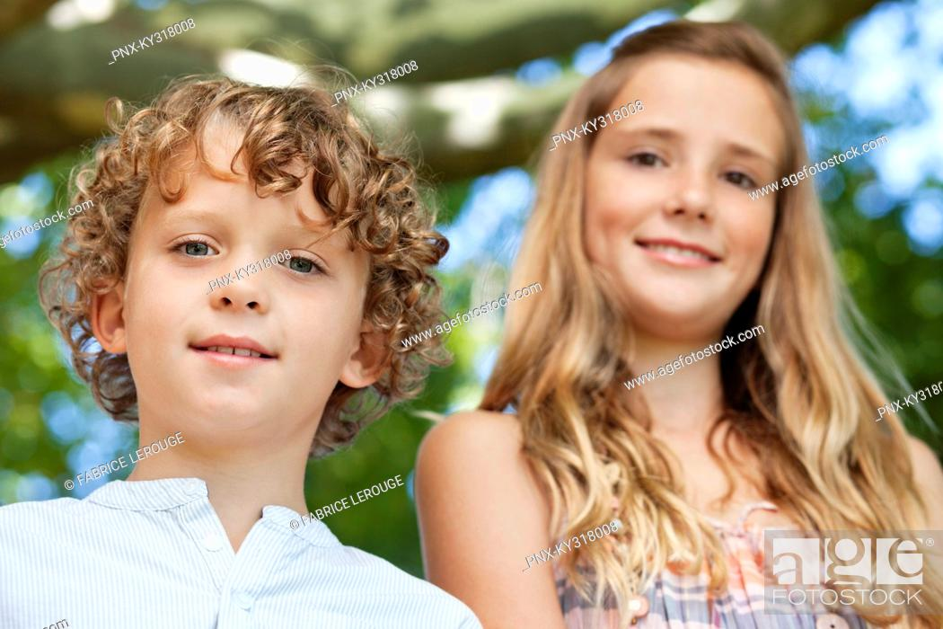 Stock Photo: Close-up of smiling brother and his sister.