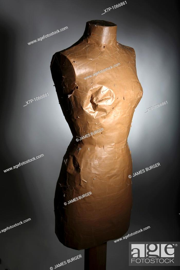 Stock Photo: A damaged dressmaking form.