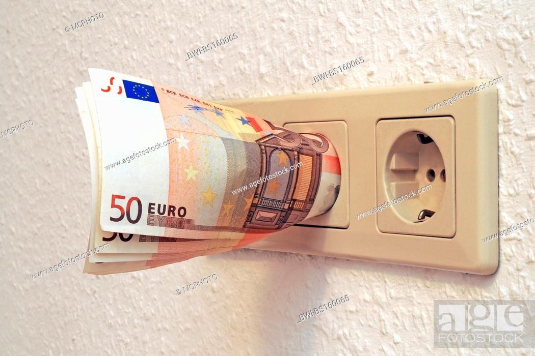 Banknotes In Power Socket Symbol For Energy Costs Germany Stock