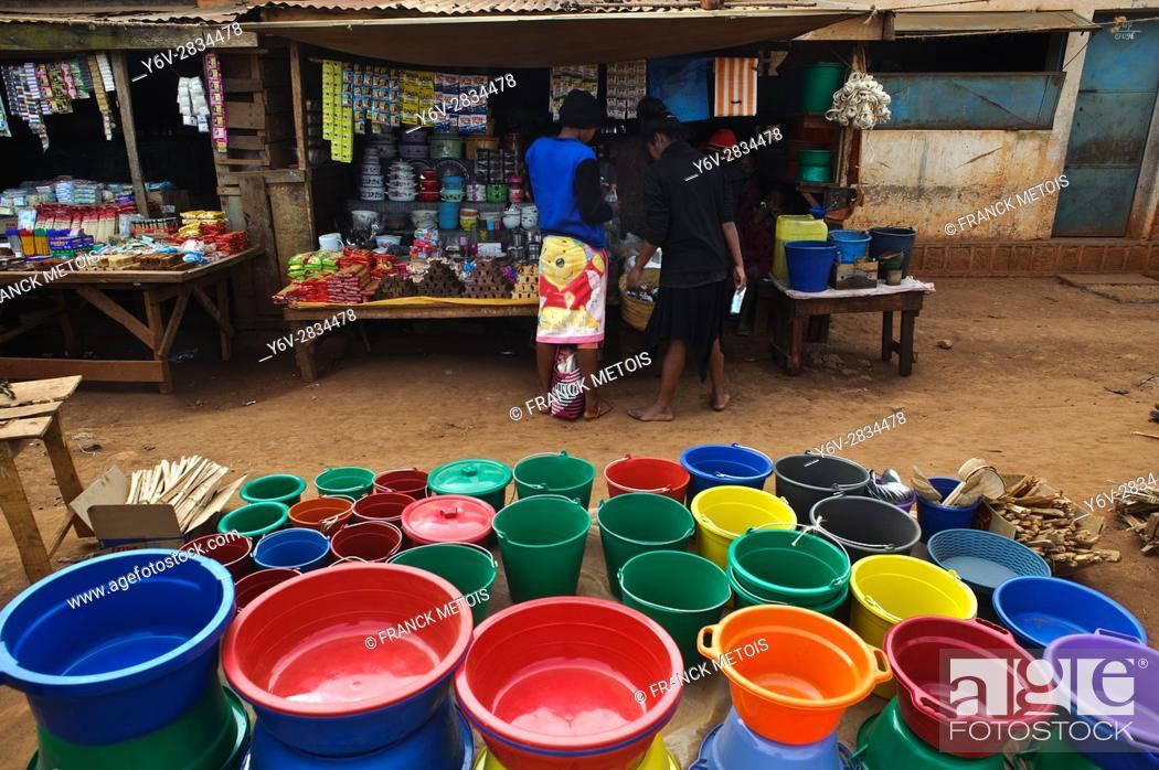 Stock Photo: Market at Ambalavao ( Madagascar). Small grocery shop selling plastic buckets.