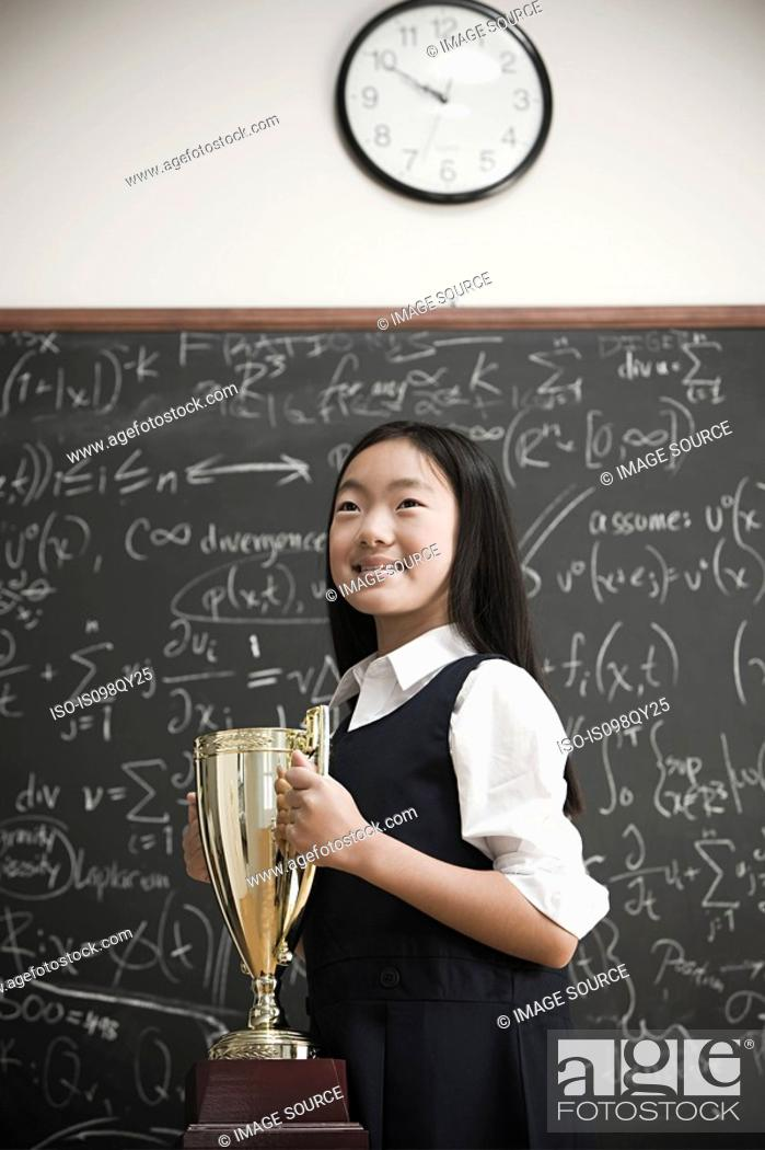 Stock Photo: Girl with trophy.