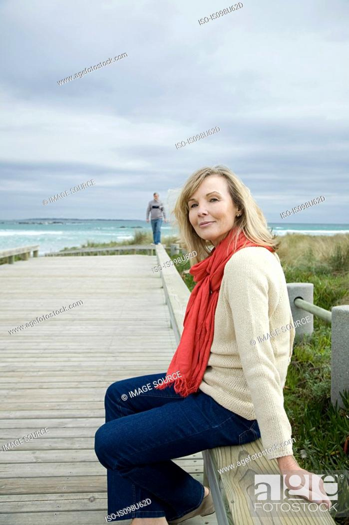 Stock Photo: Mature woman at the coast.