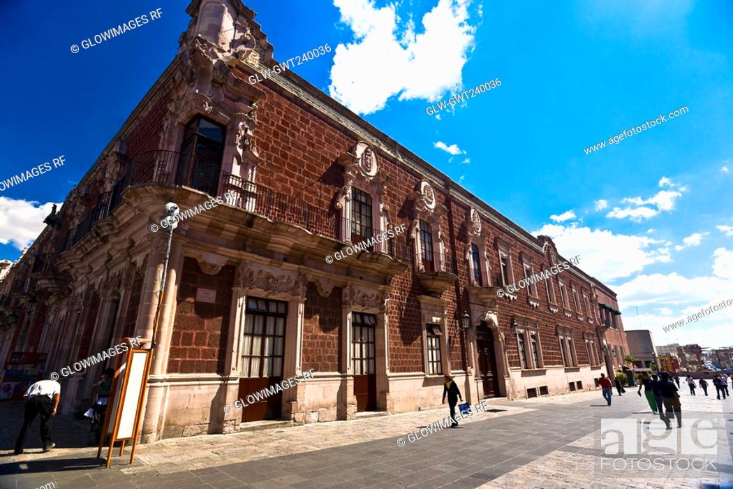 Stock Photo: Group of people walking in front of a government building, Palacio De Gobierno, Aguascalientes, Mexico.