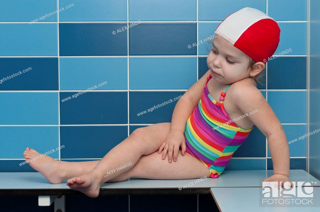 Photo de stock: Three year old girl at swimming pool ready for a swimming lesson.