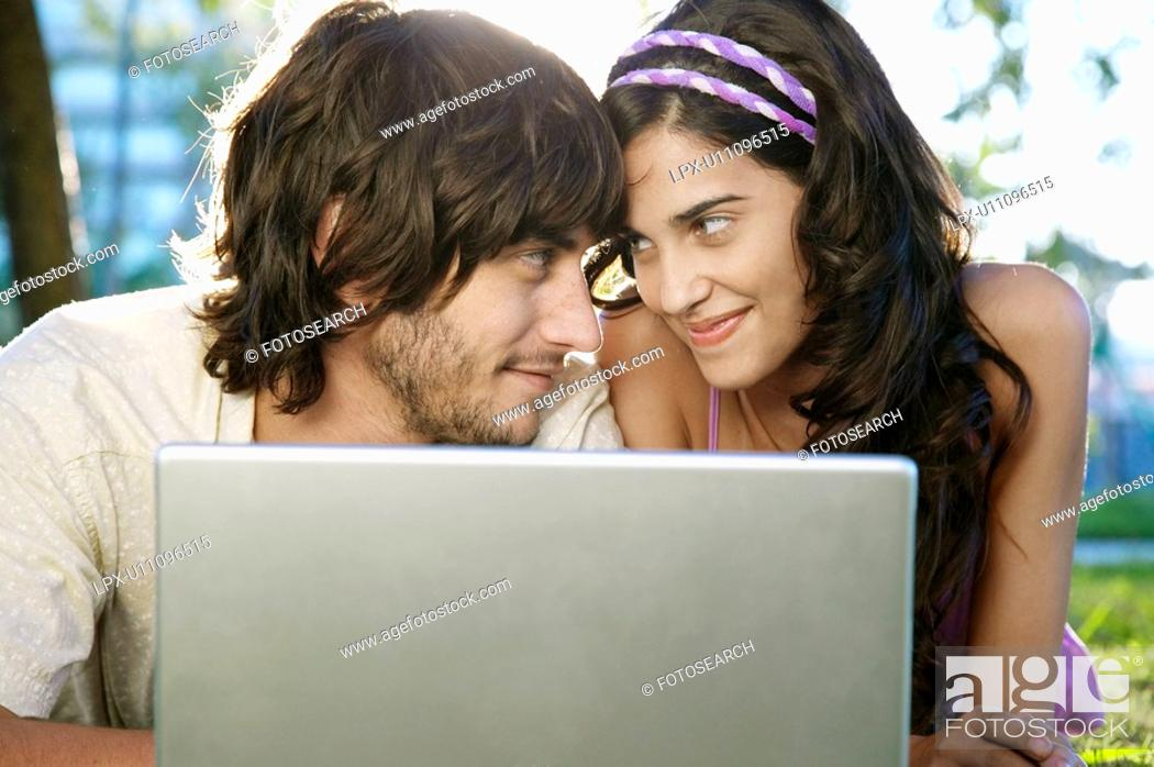 Stock Photo: Young couple using laptop.