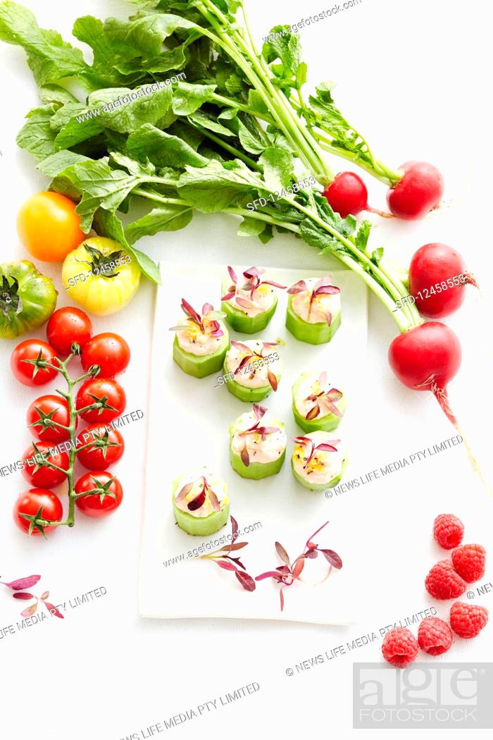 Photo de stock: Cucumber canapés with various vegetables.